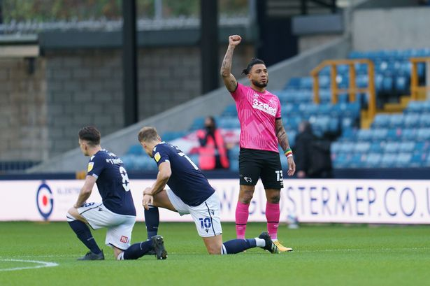 Colin Kazim-Richards of Derby stood in protest while some Millwall fans booed