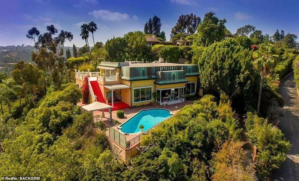 Zsa Zsa Gabor's canary-yellow former Bel Air mansion sold to diamond mogul billionairefor $16M