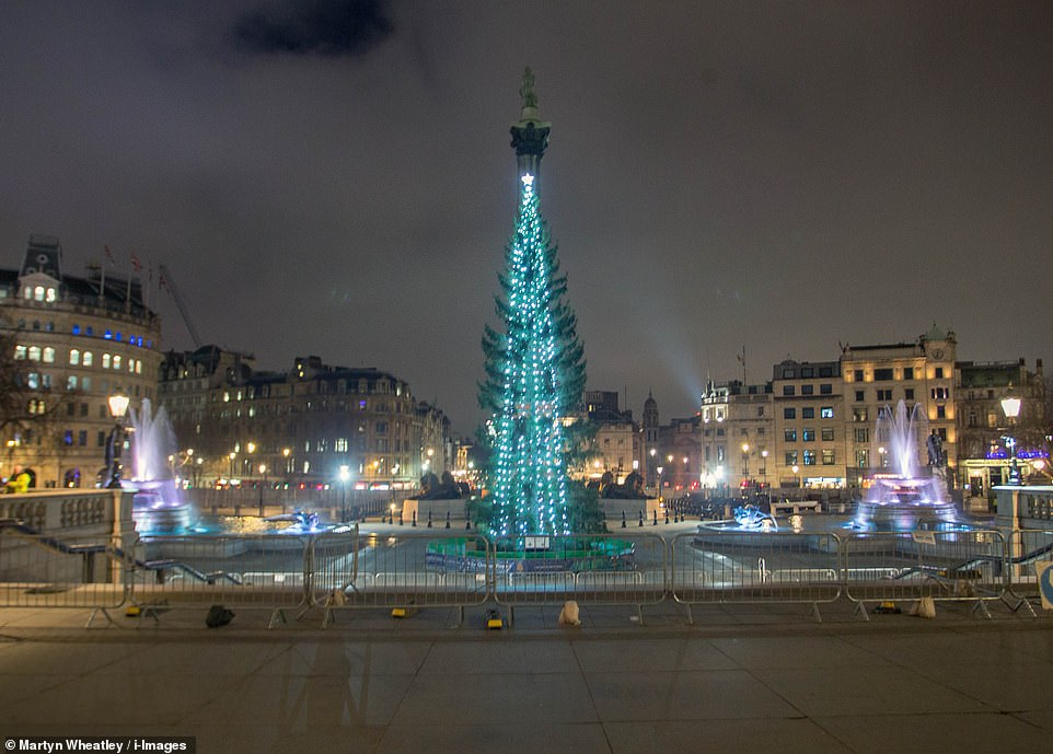 LONDON: The brightly-lit Christmas tree in Trafalgar square in the capital stood alone as large barriers blocked off rule-breaking pedestrians