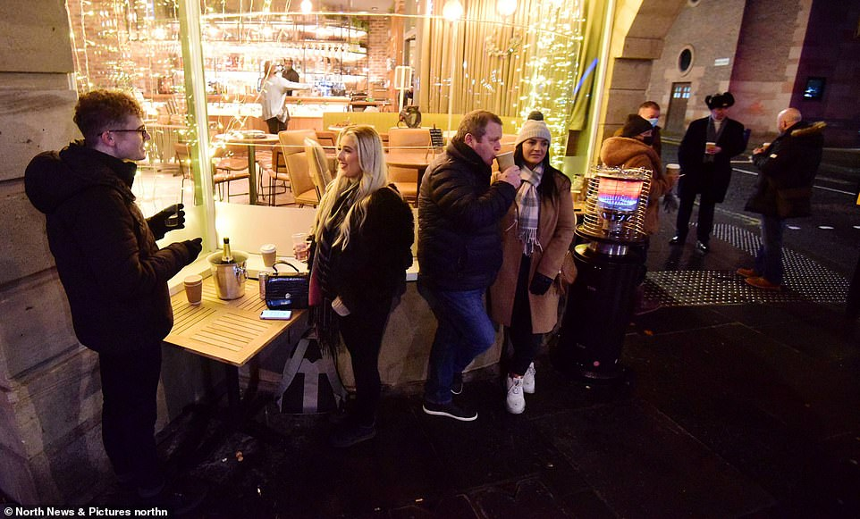 NEWCASTLE: A number of people stand around outside a restaurant on Newcastle's Quayside this evening. Some of them are seen holding and enjoying drinks