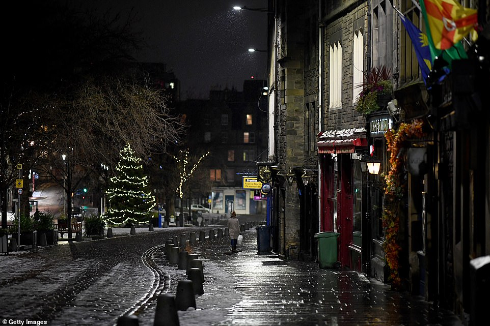 EDINBURGH: Snow is seen on the pavement in Edinburgh as Covid lockdown keeps locals inside on New Year's Eve