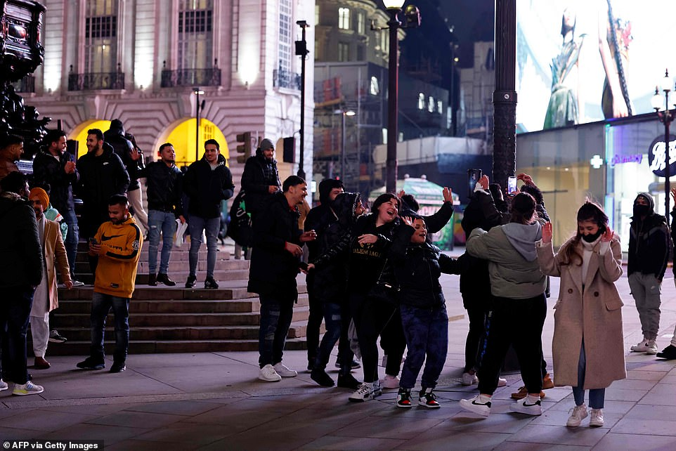 LONDON: A large group of people appear to start celebrating New Year's Eve together at Piccadilly Circus only moments after police officers and stewards leave the area to patrol other parts of the capital
