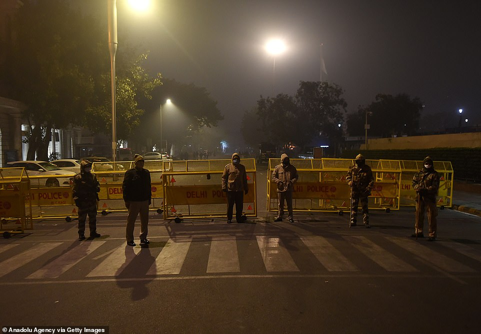 INDIA:Delhi police officers patrol at a checkpoint near Connaught Place ahead of night curfew from 11pm to 6am to avoid gatherings for the New Year celebrations due to the pandemic