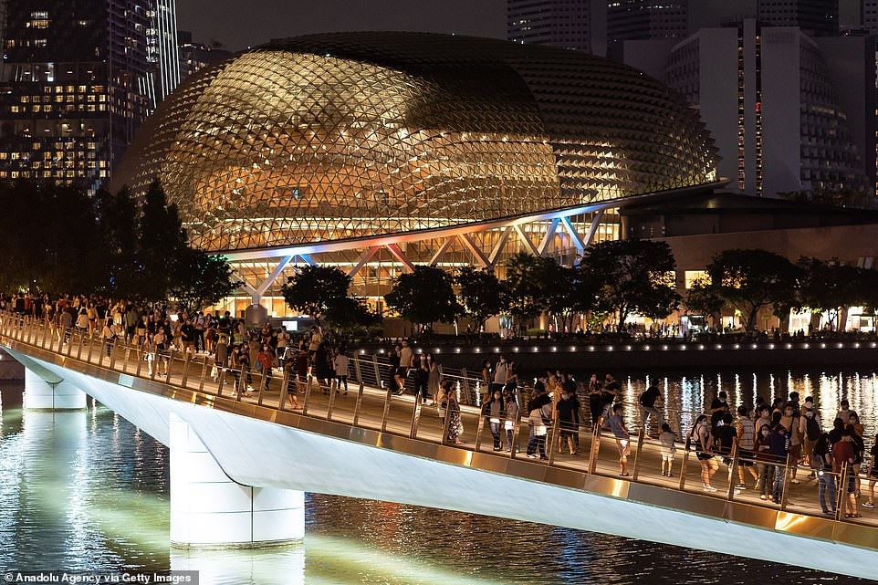 SINGAPORE: Crowds were seen gathered along a bridge to usher in the new year. There was no firework show this year, but many opted to head outdoors to see the lights