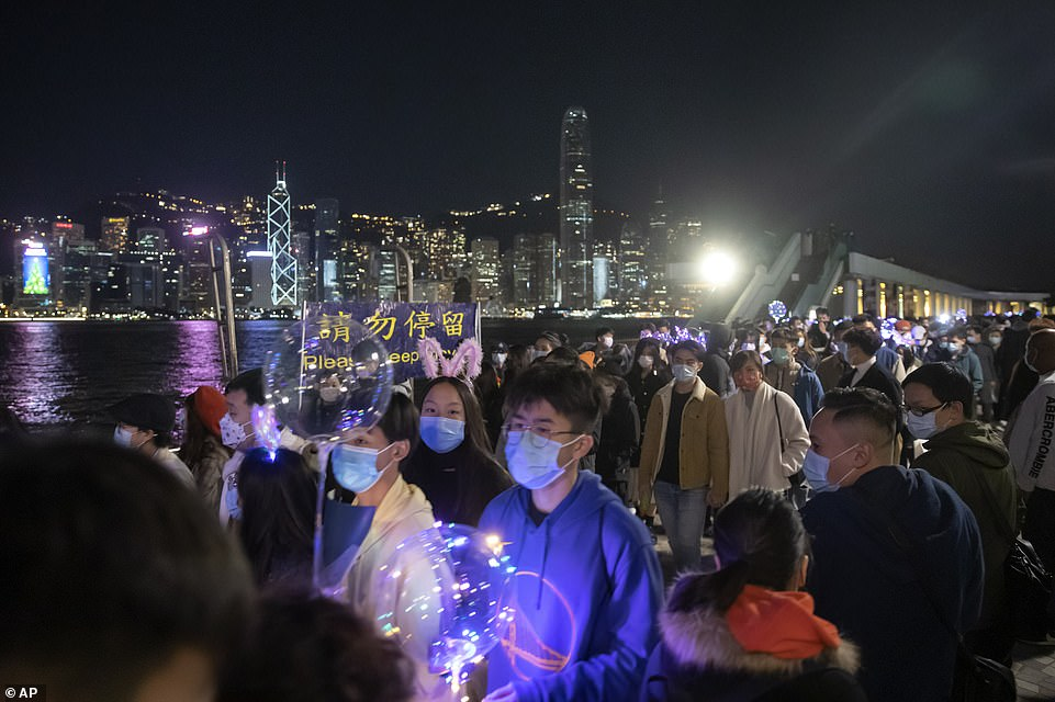 HONG KONG: Crowds of people - all wearing face masks - gathered along the water front in Hong Kong to welcome 2021