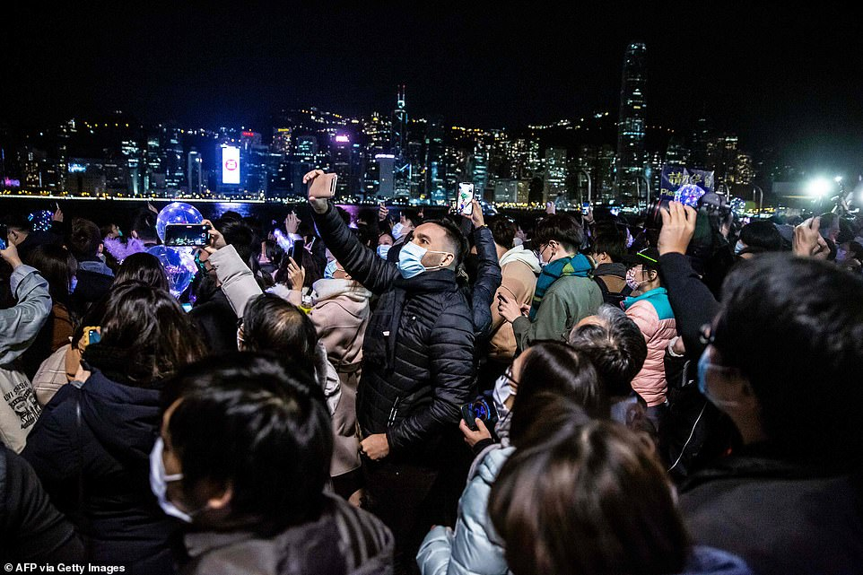 HONG KONG: Amazed onlookers snapped pictures of the city lights in Hong Kong. The amazing skyline lit up the night's sky