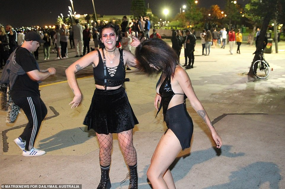 MELBOURNE: Partygoers went mask-free as they danced the last few moments of 2020 away inSt Kilda, Melbourne, tonight