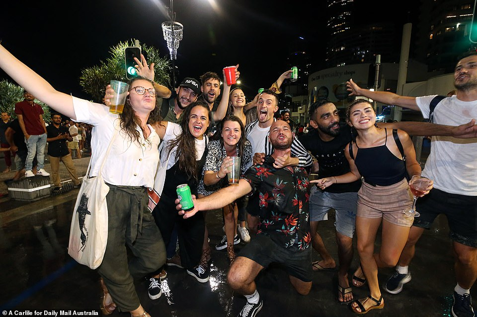 QUEENSLAND: One group posed for a picture with their arms around each other as they welcomed in the new year in Australia