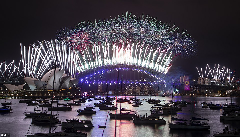 SYDNEY: Fireworks explode over Sydney's opera house and harbour bridge as celebrations begin in the first seconds of 2021
