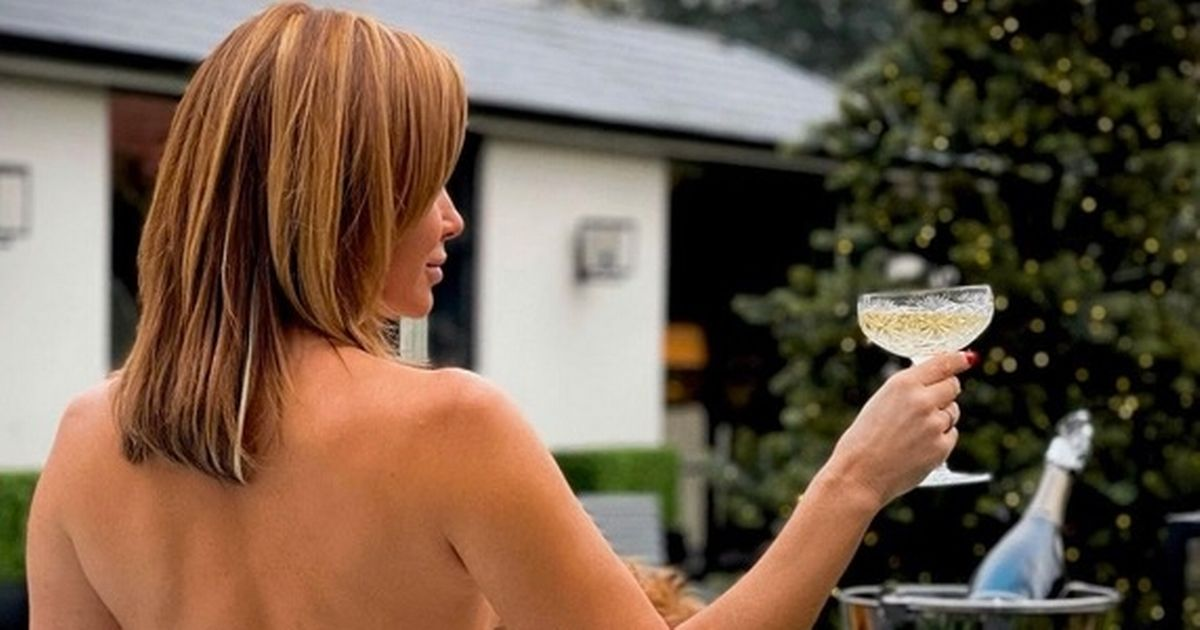 Amanda Holden goes topless in jacuzzi as she toasts with champagne to New Year