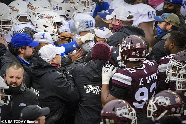 Tulsa and Mississippi State players trade blows along the Bulldogs sideline on Thursday