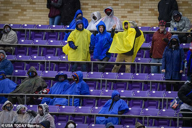 Both Tulsa and Mississippi State fans endured a rainy game before watching the brawl