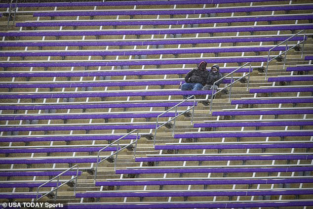 A view of fans sitting in the rain during the game between the Mississippi State Bulldogs and the Tulsa Golden Hurricane at Amon G. Carter Stadium, where attendance was limited