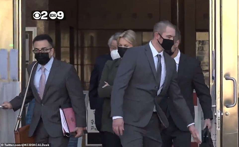 Leaving court: On Wednesday she was charged with two counts of murder, two counts of vehicular manslaughter with gross negligence, and one count of hit-and-run driving resulting in death inLos Angeles County Superior Court