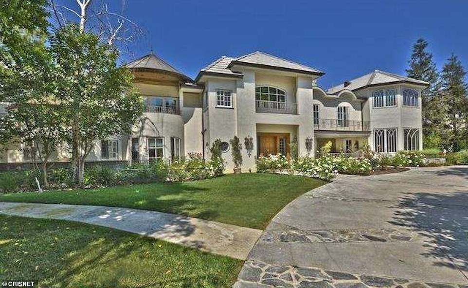 Grossman's current address is listed as a sprawling $7.6million mansion in Hidden Hills that features nine bedrooms and 12 bathrooms and is located next door to Full House actress Lori Loughlin