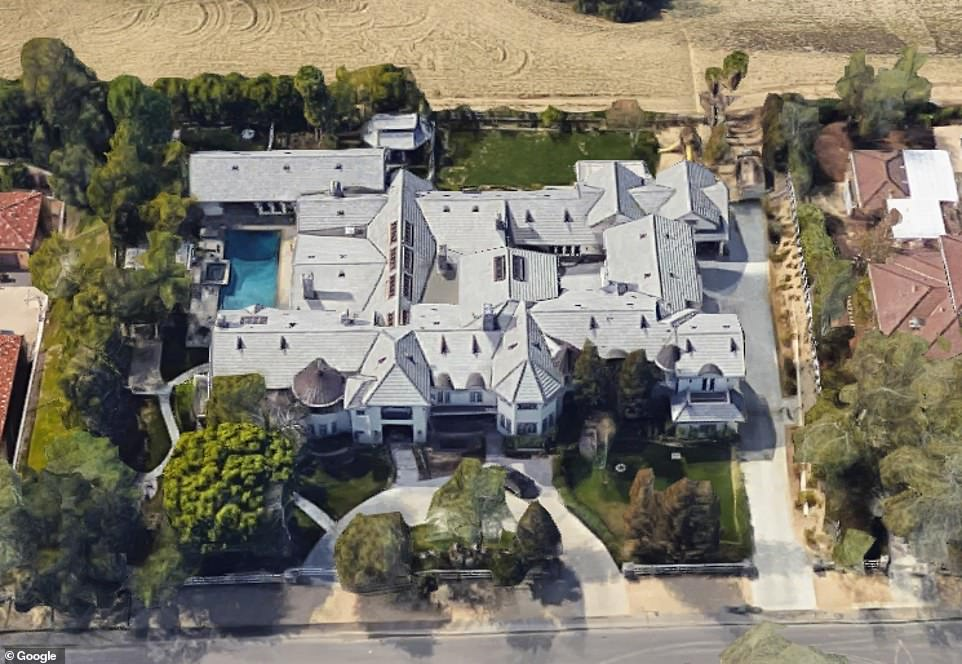 An aerial view of the massive Hidden Hills mansion above
