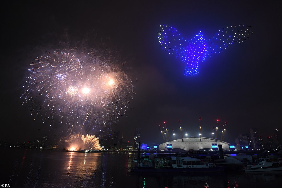 During the display, a bird appeared in the sky - in reference to the building of the Nightingale hospitals - after a clip of a news broadcast states: 'Buildings were lit up in blue, the colour of the NHS'