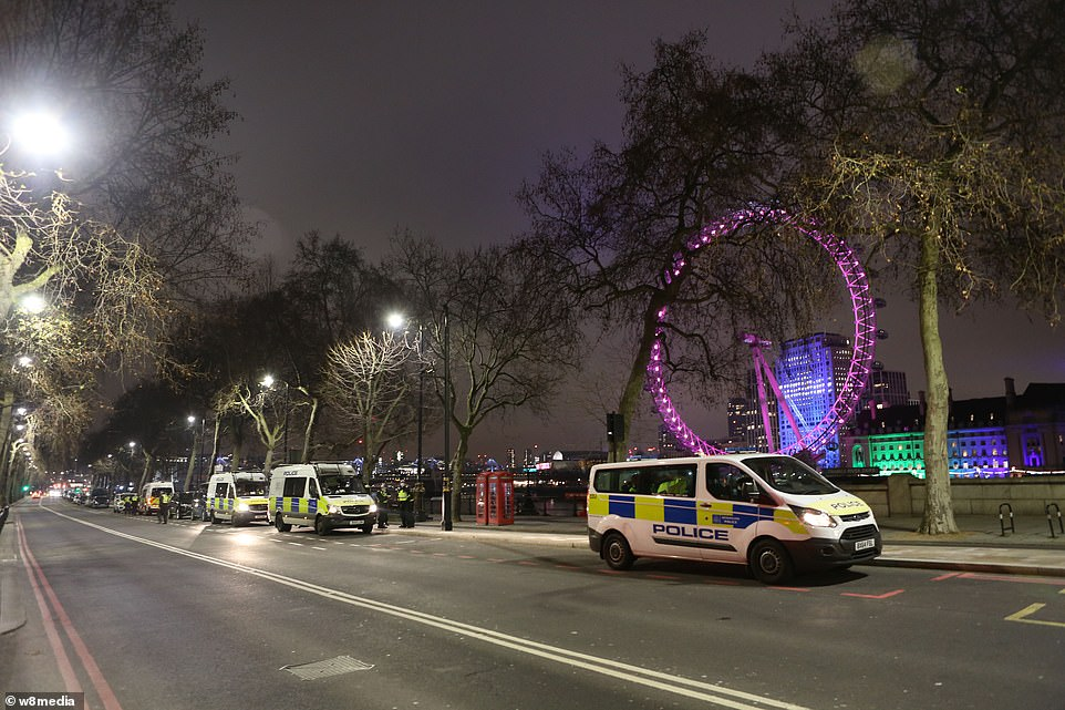 LONDON: Rows of police vehicles stand guard near to the London Eye, where this year's fireworks display has been cancelled to avoid crowds gathering