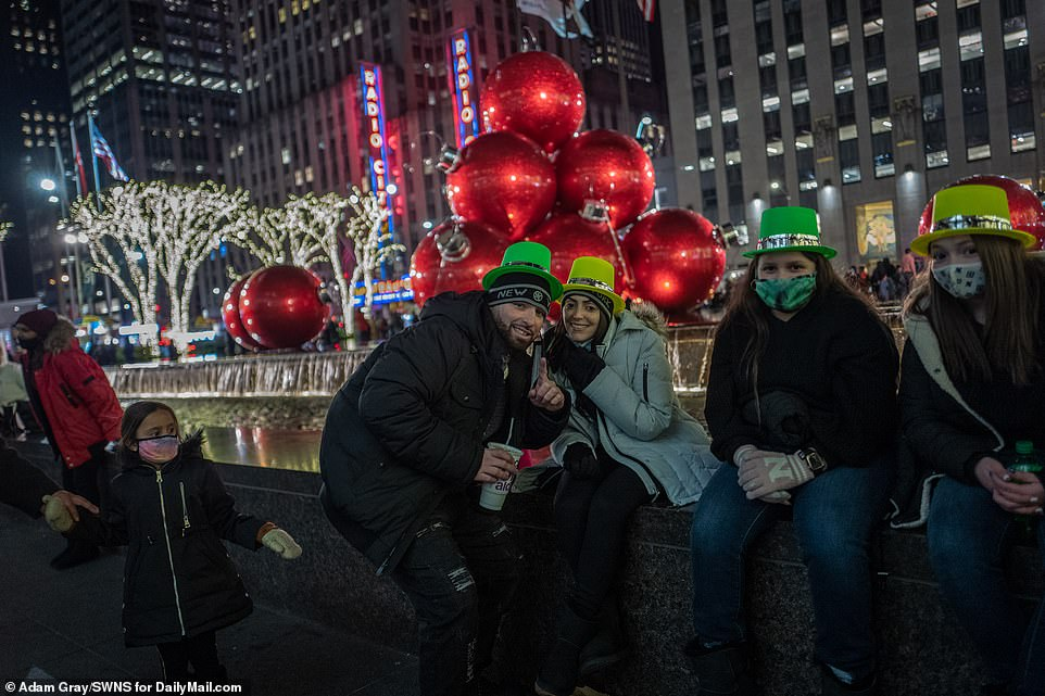 A few dozen people did gather near Times Square Thursday night wearing colorful hats and 2021 glasses