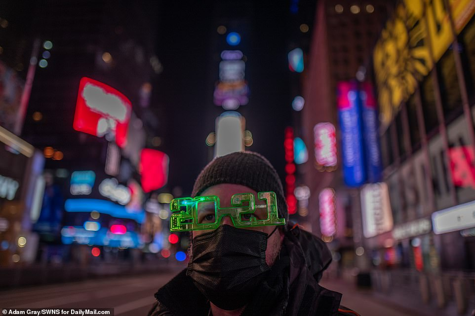 A man is seen wearing 2021 glasses ahead of the ball drop in New York City's Times Square