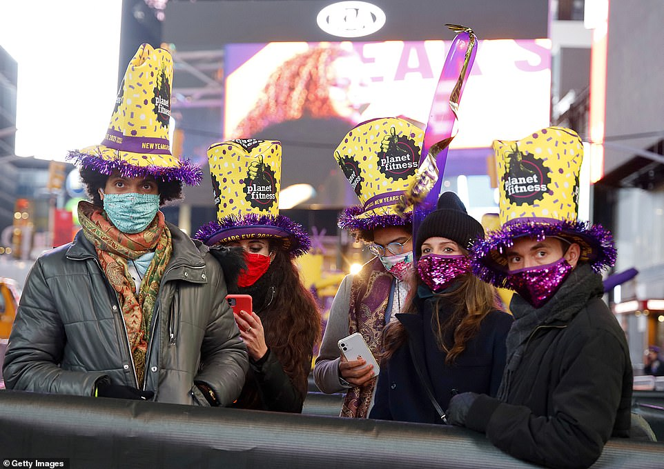 Attendees watch a performance near Times Square during 2021 New Year's Eve celebrations on Thursday in New York City