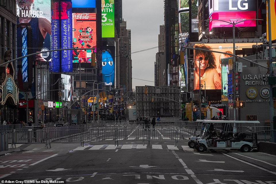 On Thursday afternoon Times Square was eerily empty, with the area cordoned off to the public and police patrolling nearby sidewalks to enforce social distancing