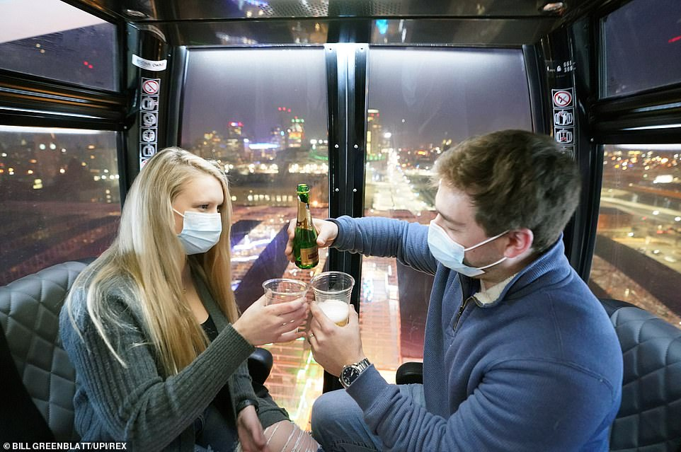 And New York is not the only state ringing in the new year differently. The US and other countries are celebrating from home or with modified events as cases of the virus continue to rise. Tyler Owens toasts to a new year with his wife Olivia Owens in St Louis, Missouri