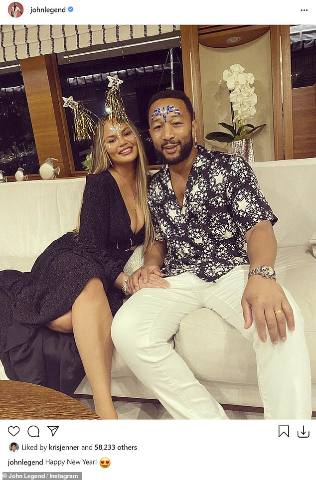 Celebrity couple: Chrissy added a sparkly headdress as she posed cuddled up to her Grammy-winning husband
