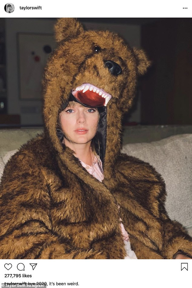 Barely bear-ing it:Taylor Swift wore a fake fur bear suit as she posed for a portrait. In her caption the 1984 crooner said, 'Bye 2020, it's been weird'