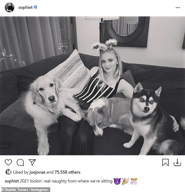 Oohh-la-la: The Game Of Thrones actress, 24, also posed in a sexy outfit with the couple's dogs