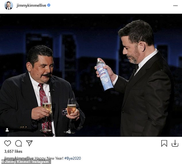 Sums it up: Late night host Jimmy Kimmel shared a photo of himself and his ABC show sidekick Guillermo. Guillermo holds two glasses of champagne while Jimmy holds a spray can of Lysol