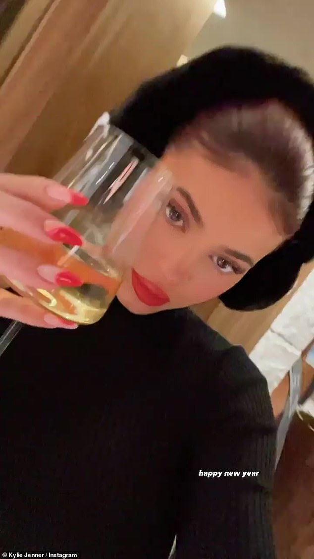 Cheers: The reality star later wished her fans a 'happy new year' as she raised a toast on camera from her celebrations