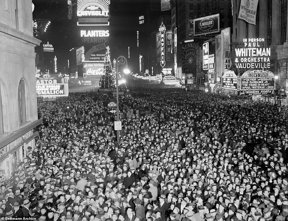 The time-honored tradition has been going since 1907. New Yorkers are pictured in Times Square on New Year's Eve 1939