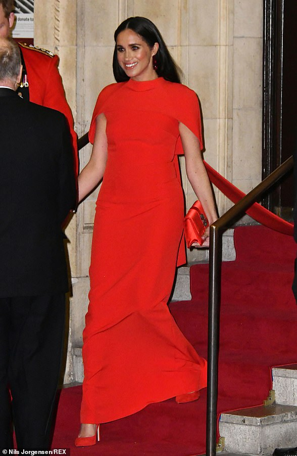 The Duchess wowed in a scarlet ensemble as she joined Prince Harry for the Mountbatten Festival of Music at the Royal Albert Hall on Saturday night