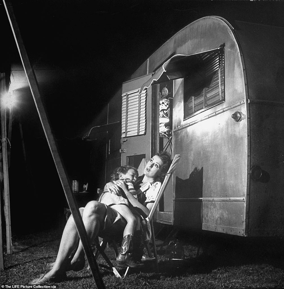 Gypsy Rose Lee sits outside her 31-foot trailer with her 4-year-old son, Erik Lee Preminger after a long night of shows. 'I love to keep house,' Lee told the reporter, 'and being on the road with Royal American Shows gives me a chance to keep house in my trailer.' As LIFE would put it: Lee 'had it soft, as carny performers' lives go. She lives in her own trailer with her third husband, the noted Spanish painter, Julio de Diego. With them is her 4-year-old son, Erik and his nurse. Gypsy, who loves to fish, carries an elaborate angler's kit, and whenever the show plays near a river, goes out and hooks fish as ably as she does customers'