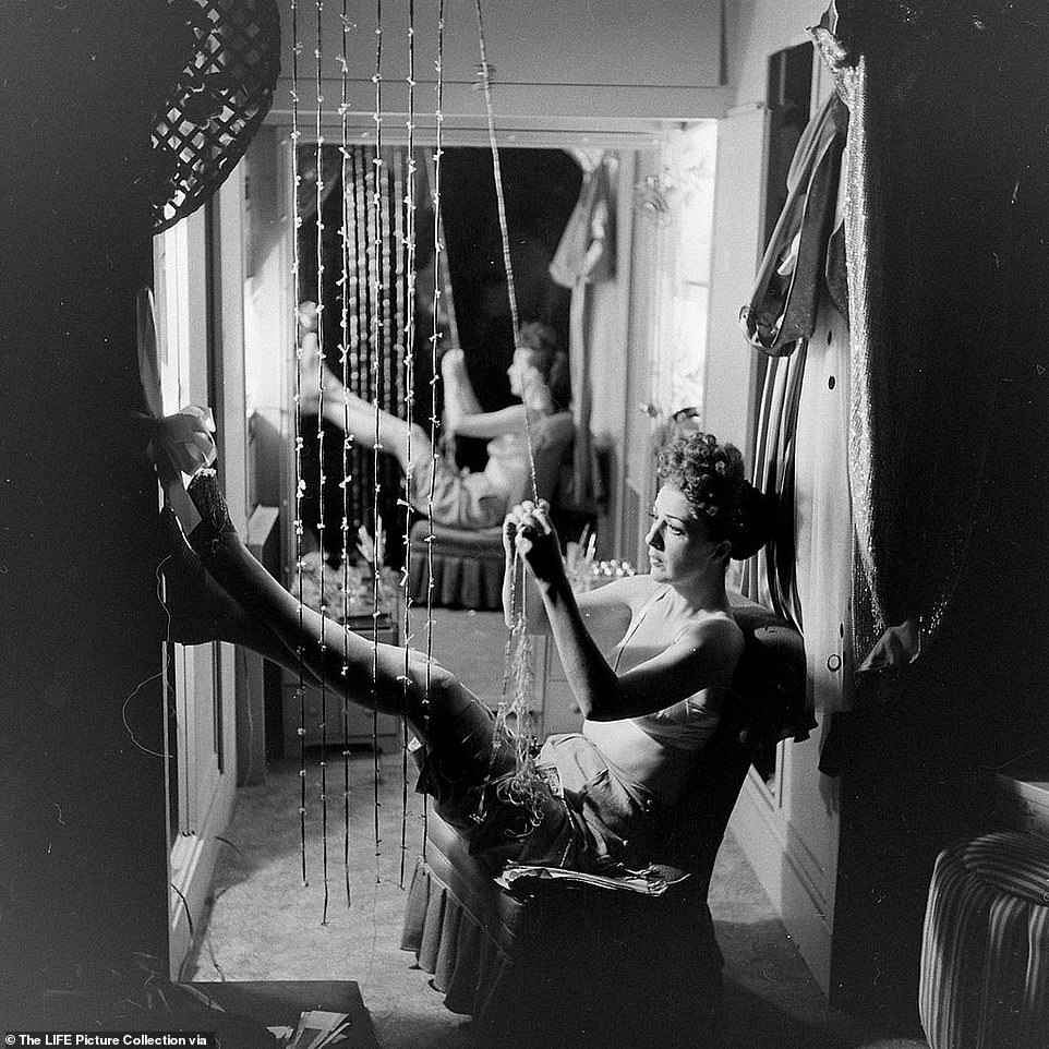 Life Magazine sent their esteemed photographer,George Skadding to cover Gypsy Lee while on tour across America. Skadding was better known for photographing American presidents, but his set of images revealed a different side to the unknowable and elusive woman who was famous for taking off her clothes. Above, Gypsy untangles a necklace in her dressing room during an unprecedented moment of stillness between shows