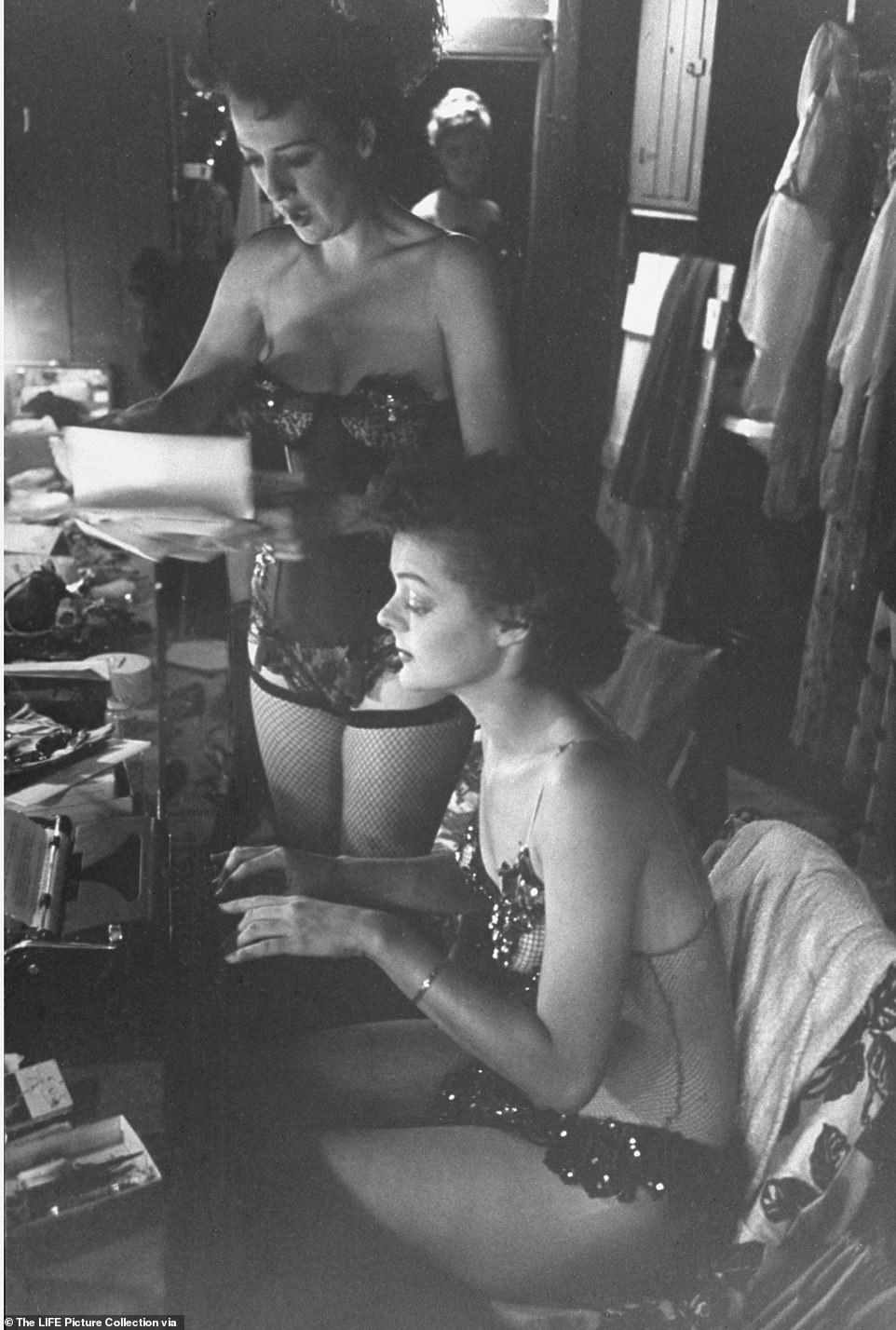 Gypsy Rose Lee (left) dictates a letter to her secretary Brandy Bryant, who was also a backup dancer in Gypsy's carnival stint. In 1941, Lee publishedThe G-String Murders, a best selling pulpy crime caper about a group of strippers that were strangled by their own G-string panties. She went on to write three more books and several screen plays that were produced on Broadway. Though nothing was as successful as her 1957 memoir Gypsy, which became one of the greatest musicals ever written, with lyrics by Stephen Sondheim
