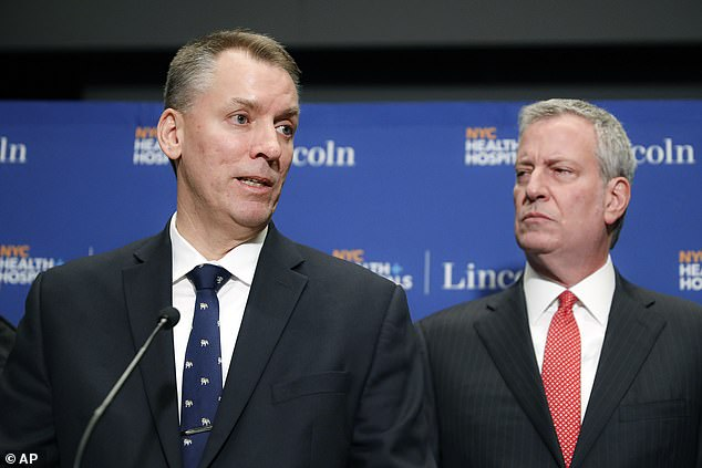 Police Commissioner Dermot Shea NYC Mayor Bill de Blasio in February. Tensions have been building between the pair after the mayor cut $1 billion from the NYPD's $6 billion budget in June. Shea described 2020 as a 'dark period' Tuesday