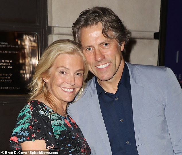 Pained:It comes after John vowed to return to work within weeks on Thursday amid his Covid-19 battle, his wife Melanie is also battling the virus (the couple pictured last year)