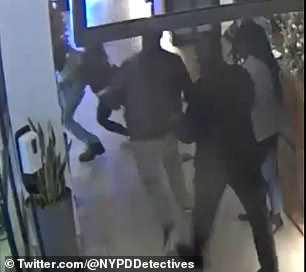 Keyon Jr. starts to walk away in the direction of the hotel doors. At this point, the woman runs and grabs the 14-year-old around the waist