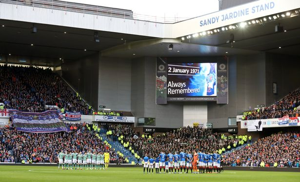 Players of Rangers and Celtic commemorating the 1971 disaster three years ago