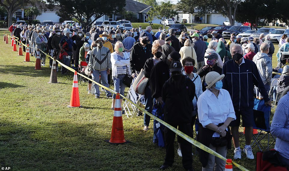 Cape Coral, Florida residents wait in line to receive a COVID-19 vaccine Wednesday morning during first day of vaccinations in the city. Florida is offering vaccines to high-risk frontline health care workers and those 65 and older