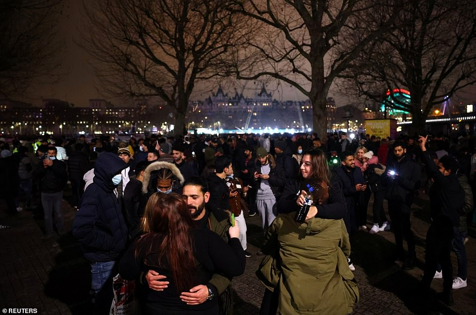 As the new year was welcomed in, crowds were seen flouting Covid lockdown rules by gathering along the river. The capital is in Tier 4