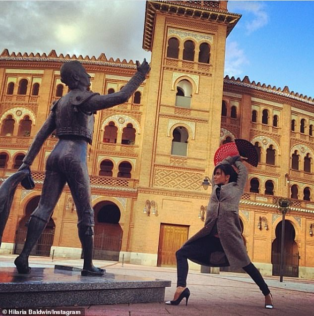 In 2014 Hilaria posted this photo with a flamenco fan and posing in front of a torrero statue with the caption: 'Hoping one day we all just dance with the bulls'