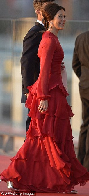 Red hot: Mary turned heads in this layered gown for a water pageant in 2013