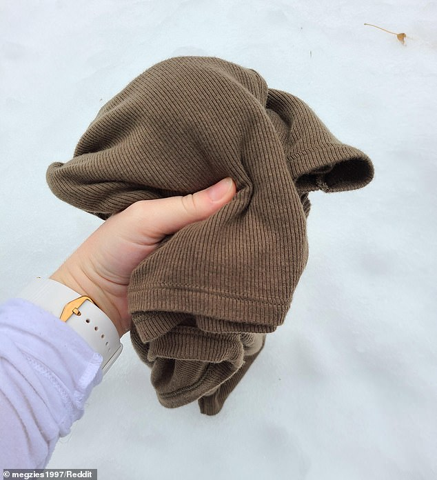 Another change! She later shared another photo of the sweater outside in front of the snow, where it looked brown
