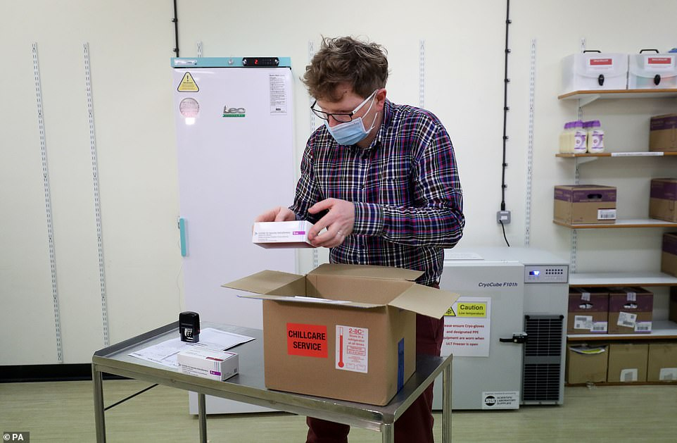 Deploying this second vaccine is another huge achievement for science and public health in the global effort to tackle Covid-19. Pictured:Assistant Technical Officer Lukasz Najdrowski unpacks doses of the Oxford University/AstraZeneca Covid-19 vaccine as they arrive at the Princess Royal Hospital in Haywards Heath, West Sussex