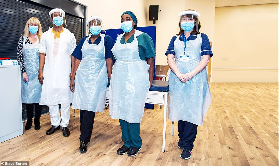 Across the UK, the NHS will now prioritise giving the first dose of the vaccine to those in the most high-risk groups, with a second dose due to be administered within 12 weeks of the first. Pictured: Staff at a vaccination centre in Wickford, Essex