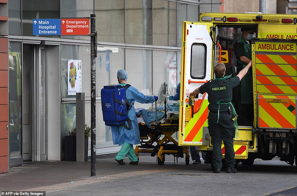 London Ambulance staff stretcher a patient from the ambulance into The Royal London Hospital in east London, on Saturday
