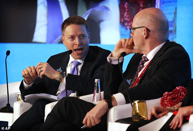 Mr Pottinger (left) told politicians from around the world that even China's leaders now openly admit their previous claims that the virus originated in a Wuhan market are false.